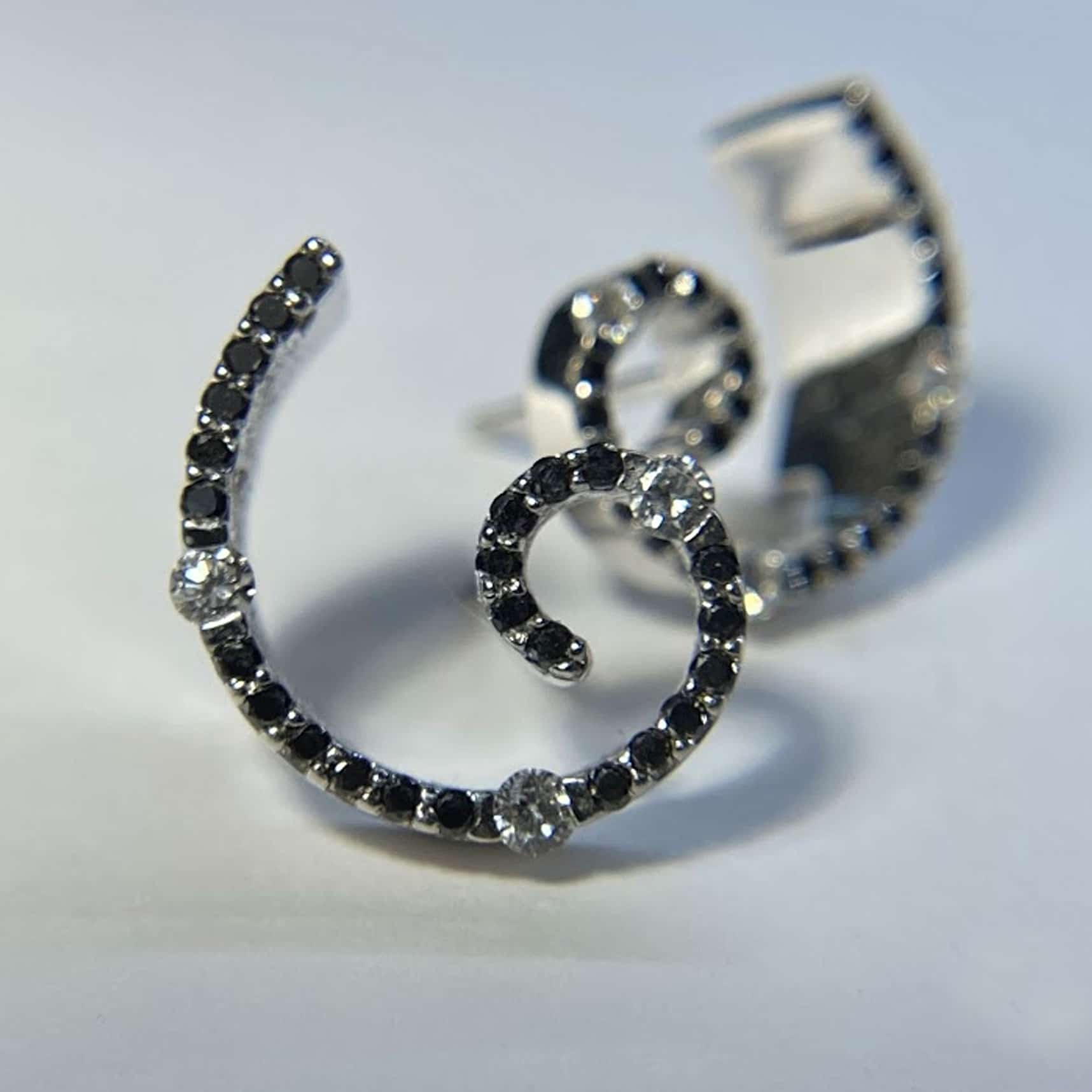 Contemporary Black and White Diamond Spiral Earrings