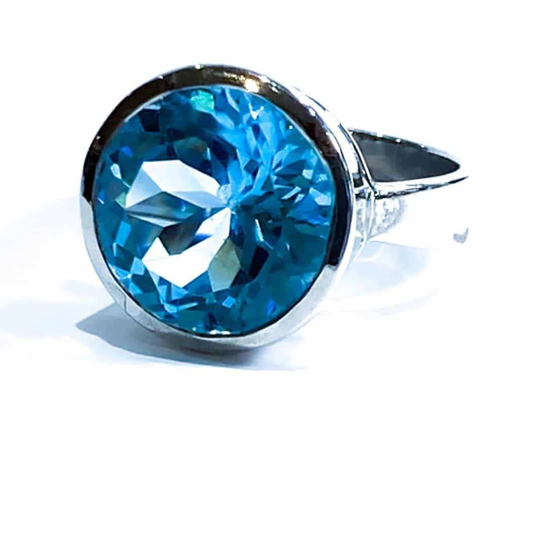 Silver Lady's Ring With Topaz Round